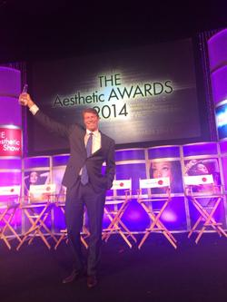 Dr. Lane Smith winning the Aesthetic Award in 2014