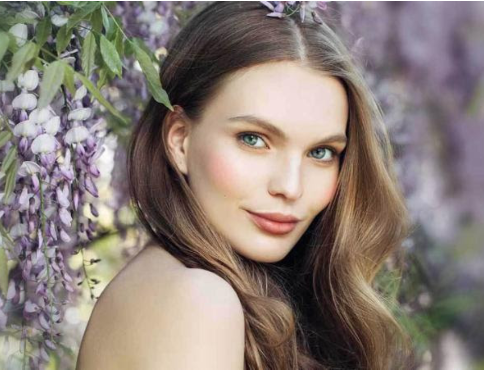 Image of woman with purple flowers in background for March Specials at Smith Plastic Surgery and Chic La Vie Med Spa in Las Vegas